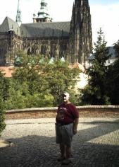 Near the Castle of Prague, standing in front of the Cathedral of Prague, in Czech Republic.