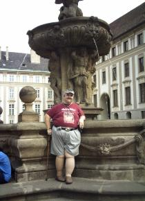 Me standing by a fountain near the Castle of Prague in Czech Republic.
